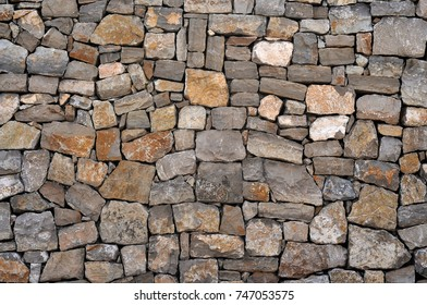 An old brown colors stone wall background.