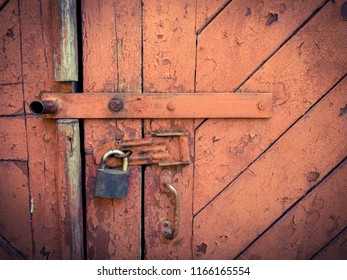 old brown door with a lock