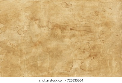Old brown paper texture with stains background