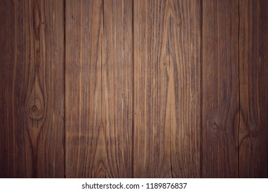 An old brown texture wooden background.
