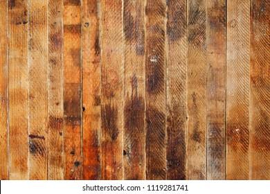Old brown vintage grunge background made of vertical wooden boards.