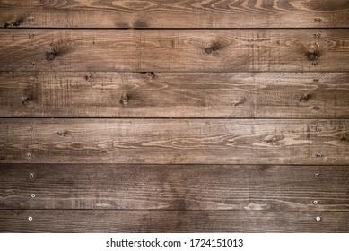 Antaño fondo de madera marrón, de madera oscura natural, en un estilo muy grunge. La vista desde arriba Textura natural de pino conífero en bruto. La superficie de la mesa a disparar se posó. Copiar espacio