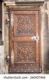 Old brown wooden door in Plzen, Czech