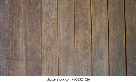 Old brown wooden floor or wall texture background with vertical line tiles