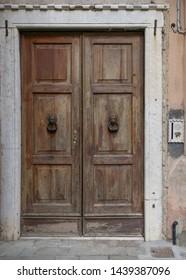 Old brown wooden Italian door, Venice, Italy