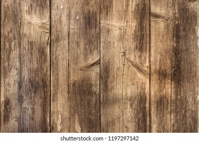 An old brown worn wood board background, texture