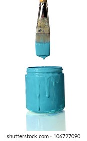 Old brush dripping teal paint into can of teal paint isolated over white background