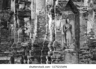 Old Buddha statue and ruin buildings at Ayutthaya historical park, Thailand. Black and white image
