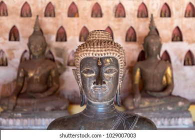 Old Buddha statues at early 19th century Wat Sisaket.