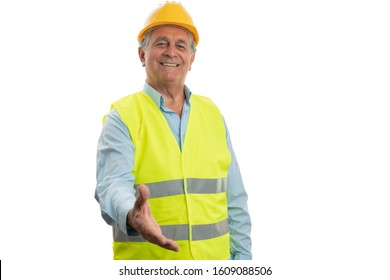 Old builder man with friendly expression offering handshake as greeting isolated on white background