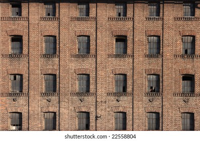 Old building built from bricks with many symmetrical windows