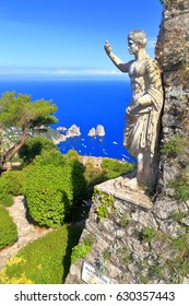 Old building decorated with Roman statue on Monte Solaro, Capri island, Italy