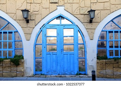 Old building facade with blue door and window, Larnaca, Cyprus