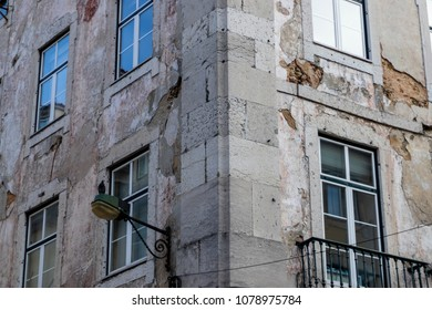 Old building facade with windows and street lamp in Lisbon, Portugal