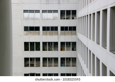Old building in the hospital Looks to have a window, I feel depressed, repetitious, monotonous and tired, All the walls are opaque, The old look but a very strong structure.