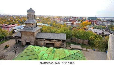 The old building made of wooden logs. The area in front of the Museum of History of Tomsk. View from above. Tomsk history. Ancient Tomsk.