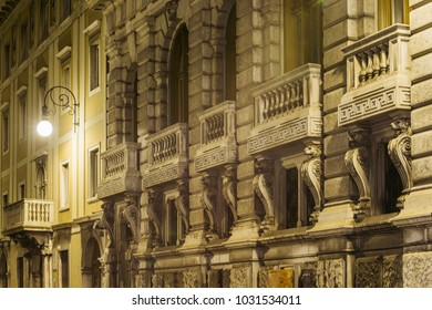 old building with massive balconies by night in Trieste, Italy