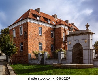 Old Building Of Red Brick. Gniezno, Is A City Located In Northern Poland,