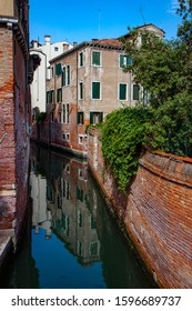 Old Building Reflected in Narrow Canal in Venice