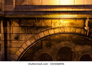 Old building texture with golden reflections