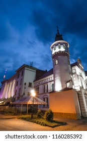 Old building with tower  view at night in Ivano-Frankivsk city