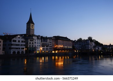 old building in zurich by a river
