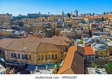 The old buildings of the Christian Quarter, covered with the red tile, from the bell tower of the Lutheran Kirche of the Redeemer, Jerusalem, Israel.
