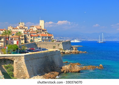 Old buildings and fortified walls of Antibes near the Mediterranean sea, French Riviera, France