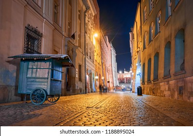 Old buildings in the historic district of Krakow at night