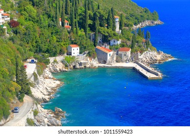 Old buildings on the Adriatic sea ahore near the harbor of Trsteno, Croatia