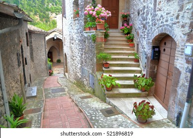 Old buildings on narrow street from the medieval village of Scheggino, region of Umbria, Italy