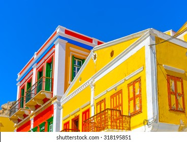 Old buildings on the pictorial port of Symi island in Greece