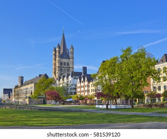 Old buildings on the Rhine embankment in Cologne, Germany with Great St Martin church