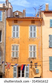 Old buildings painted yellow in the old town of Saint Tropez, French Riviera, France