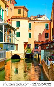 Old buildings and picturesque small canal in Treviso in the summer, Veneto, Italy