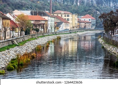 Old buildings are reflected in Jihlava river, Trebic, Czech republic. Travel destination. Architectural theme.