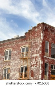 """Old buildings in """"Old Town"""" in Wichita, Kansas are getting a face-lift and remodeling.  This building has old sign for tanned leather."""