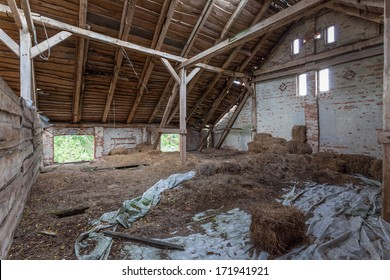 Old, built of wood and brick, abandoned barn