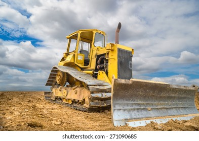 Old bulldozer Tractor on blue sky