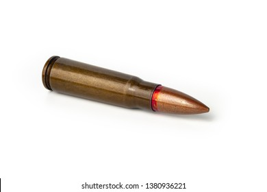 Old bullet for an automatic rifle 7.62 on a white background. Selective focus.
