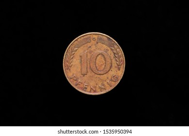 Old Bundesrepublik Deutschland or Federal Republic of Germany 10 Pfennig coin from 1950, reverse. Isolated on black background