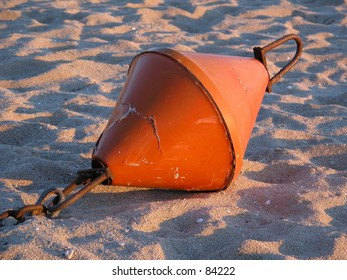Old buoy in the sand