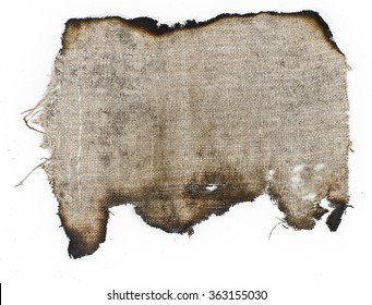 old burnt linen cloth on a white surface