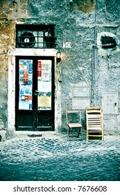 old business in the ghetto neighbourhood in Roma. Wall is dirty and broken