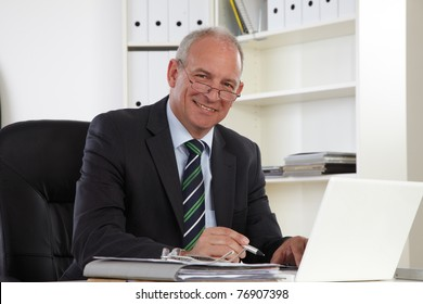 Old Business man with Laptop