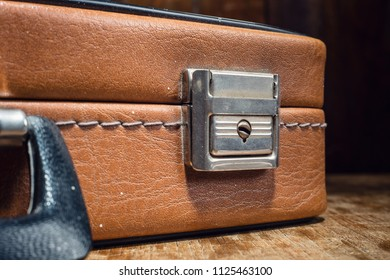 Old business suitcase close up.