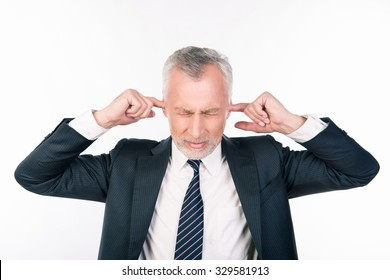 old businessman covering his ears, concept of business man stressed, headache, depressed, pain, closed eyes wear elegant shirt and tie isolated over white background