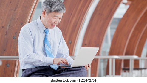 old businessman sit and use notebook work