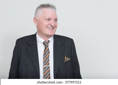 Old businessman smiling