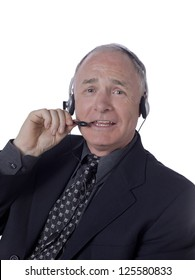Old businessman wearing headset